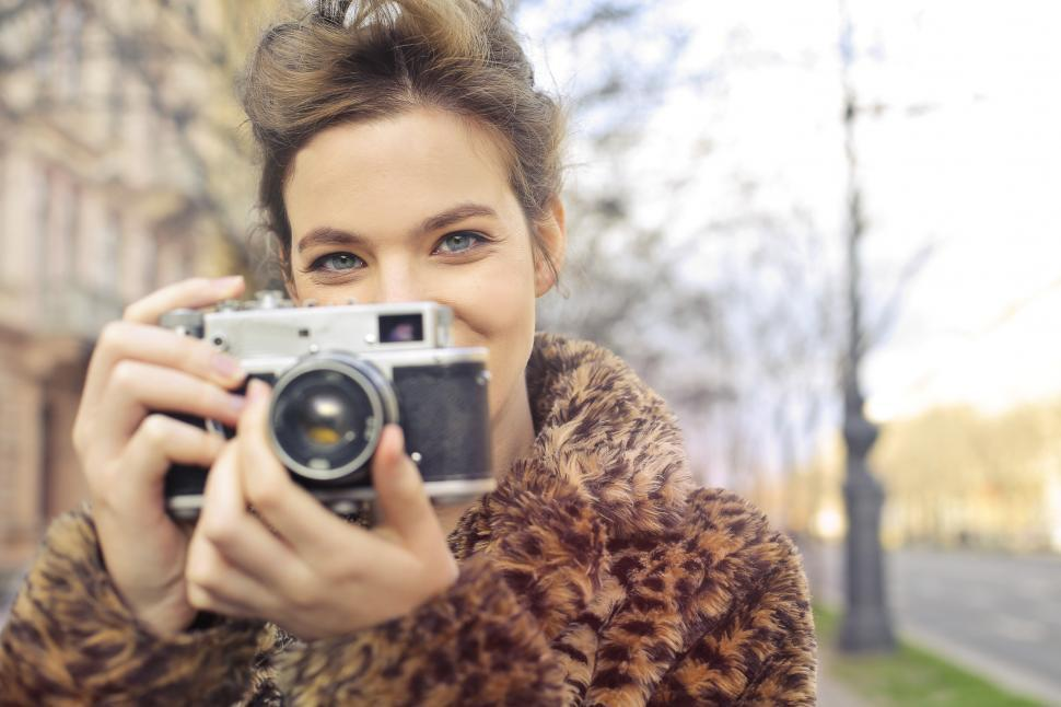 Download Free Stock HD Photo of A young blonde woman posing with a vintage camera Online