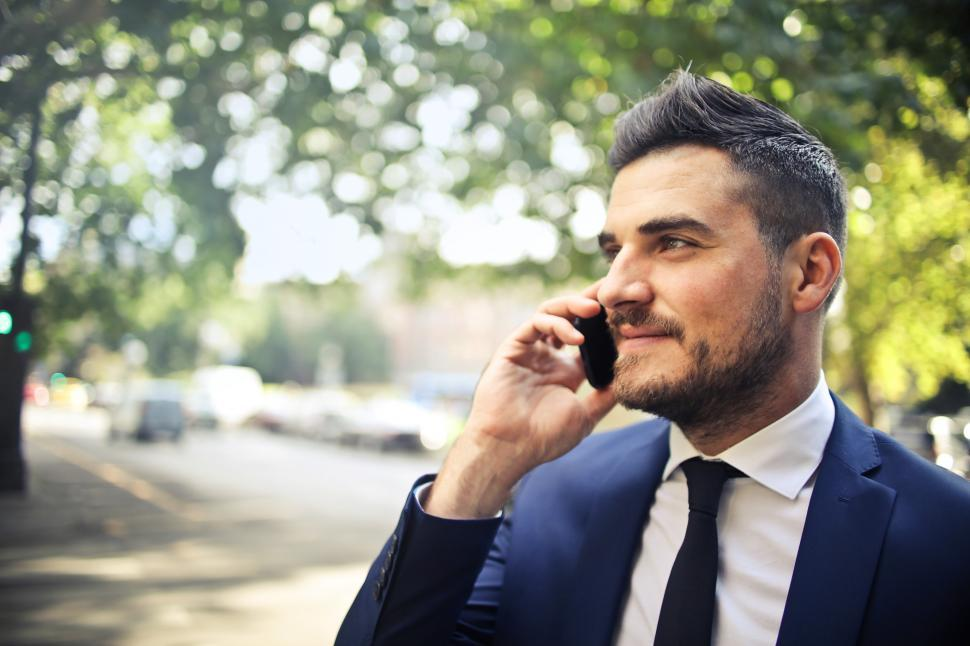 Download Free Stock HD Photo of A bearded caucasian man in formals calling on his mobile phone Online