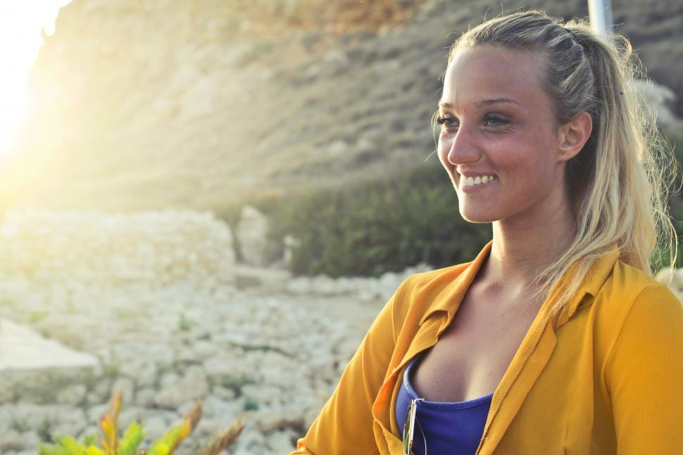 Download Free Stock HD Photo of A young blonde woman in yellow button-up shirt posing in the sun Online