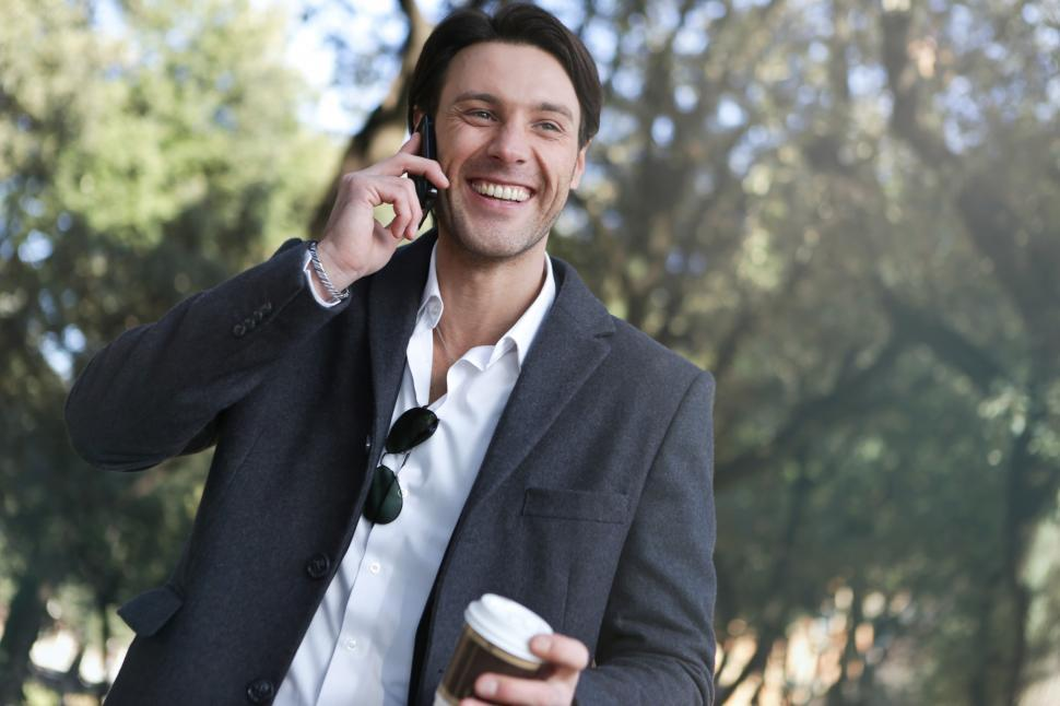 Download Free Stock HD Photo of A young caucasian man calling on his mobile phone outdoors Online