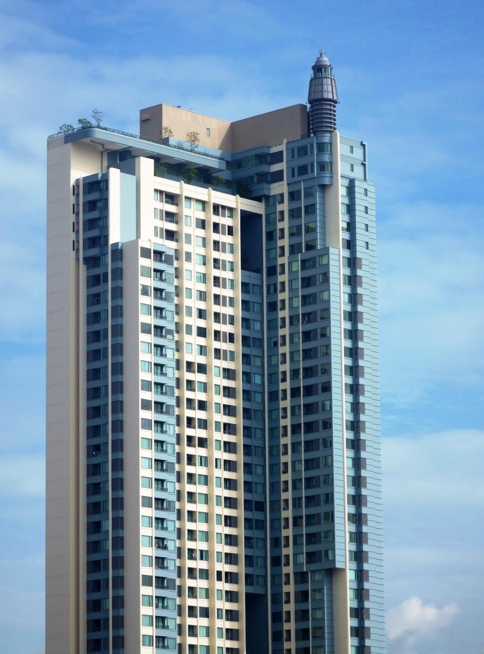 Download Free Stock HD Photo of Generic high-rise condominium building against a blue sky background  Online