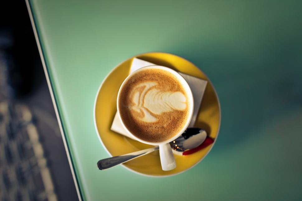 Download Free Stock HD Photo of A coffee cup kept on a table Online