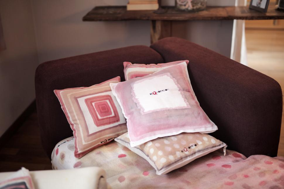 Download Free Stock HD Photo of Assorted cushions placed on a brown couch Online