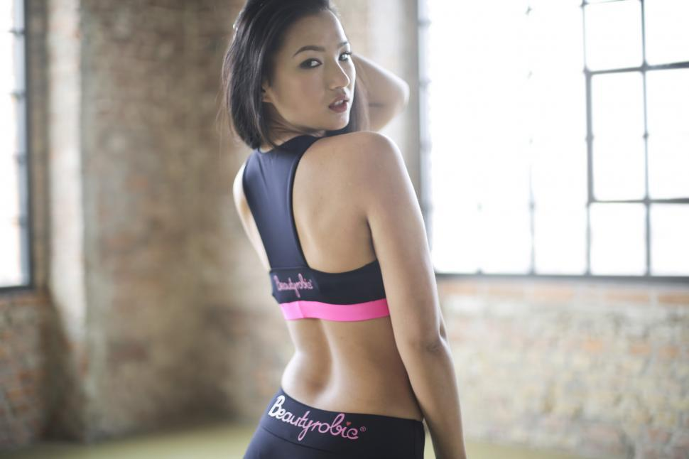 A young Asian woman in sports bra
