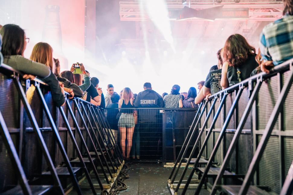 Download Free Stock HD Photo of A view of concert audience from crowd control barrier Online