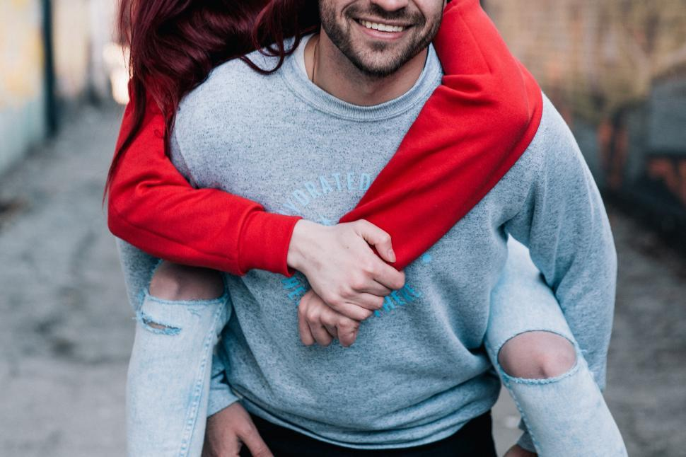 Download Free Stock HD Photo of A young caucasian couple piggyback Online