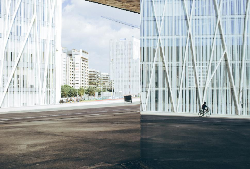 Download Free Stock HD Photo of Cycling down a modern building block Online