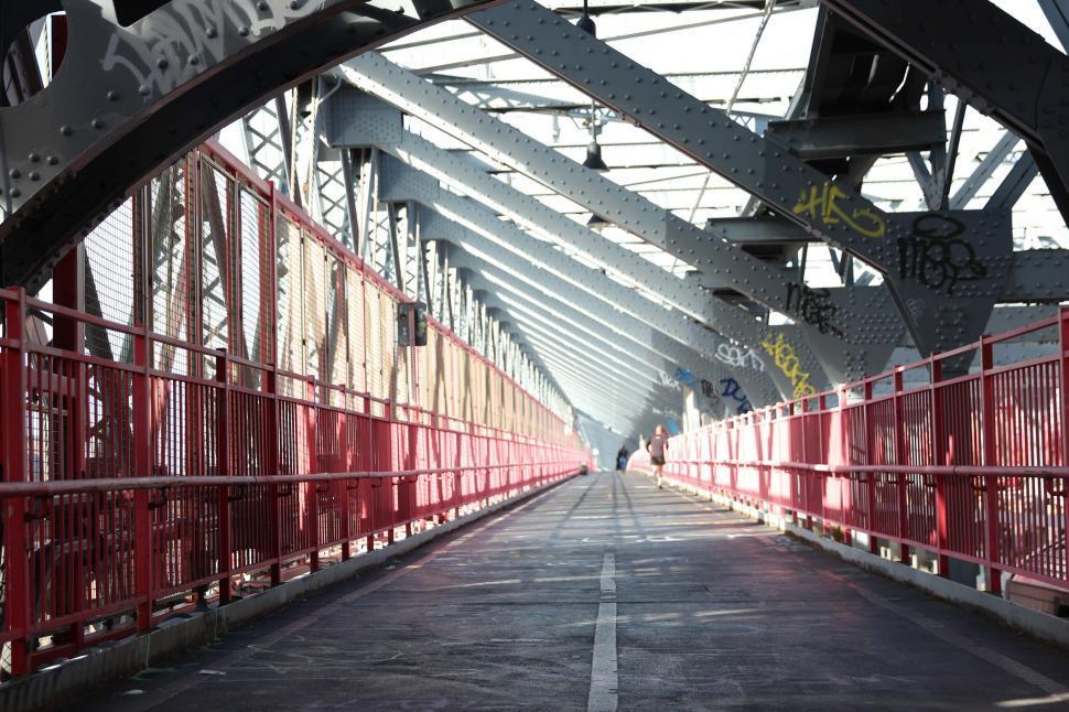 Download Free Stock HD Photo of A caged-design iron walking bridge Online