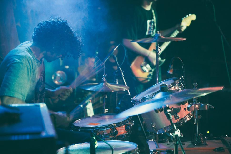 Download Free Stock HD Photo of A drummer playing along with a guitarist in a concert Online