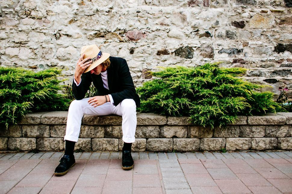 Download Free Stock HD Photo of A young caucasian man wearing hat posing outdoors Online