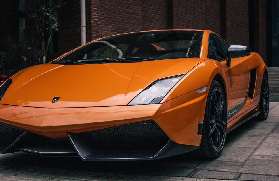 Download Free Stock HD Photo of Side view of orange lamborghini Online