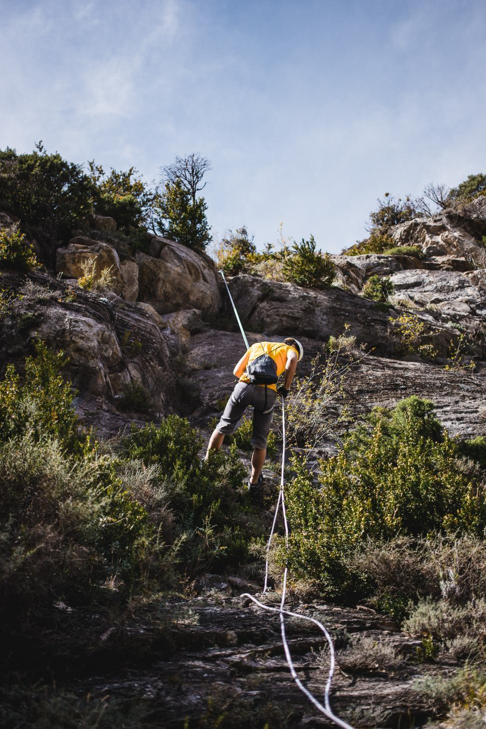 Download Free Stock HD Photo of A climber repelling a mountain Online