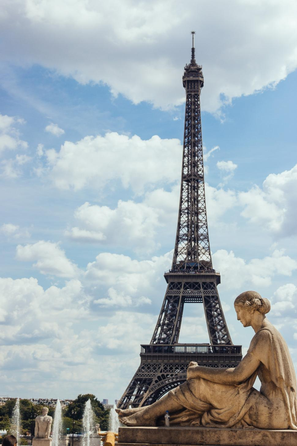 Download Free Stock HD Photo of A statue of woman with Eiffel Tower in the  background Online