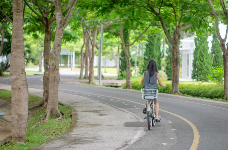 Download Free Stock HD Photo of Green Road with Cyclist Riding Online