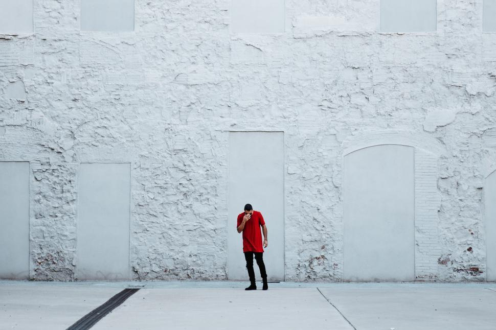 Download Free Stock HD Photo of A fashionable man by textured wall Online