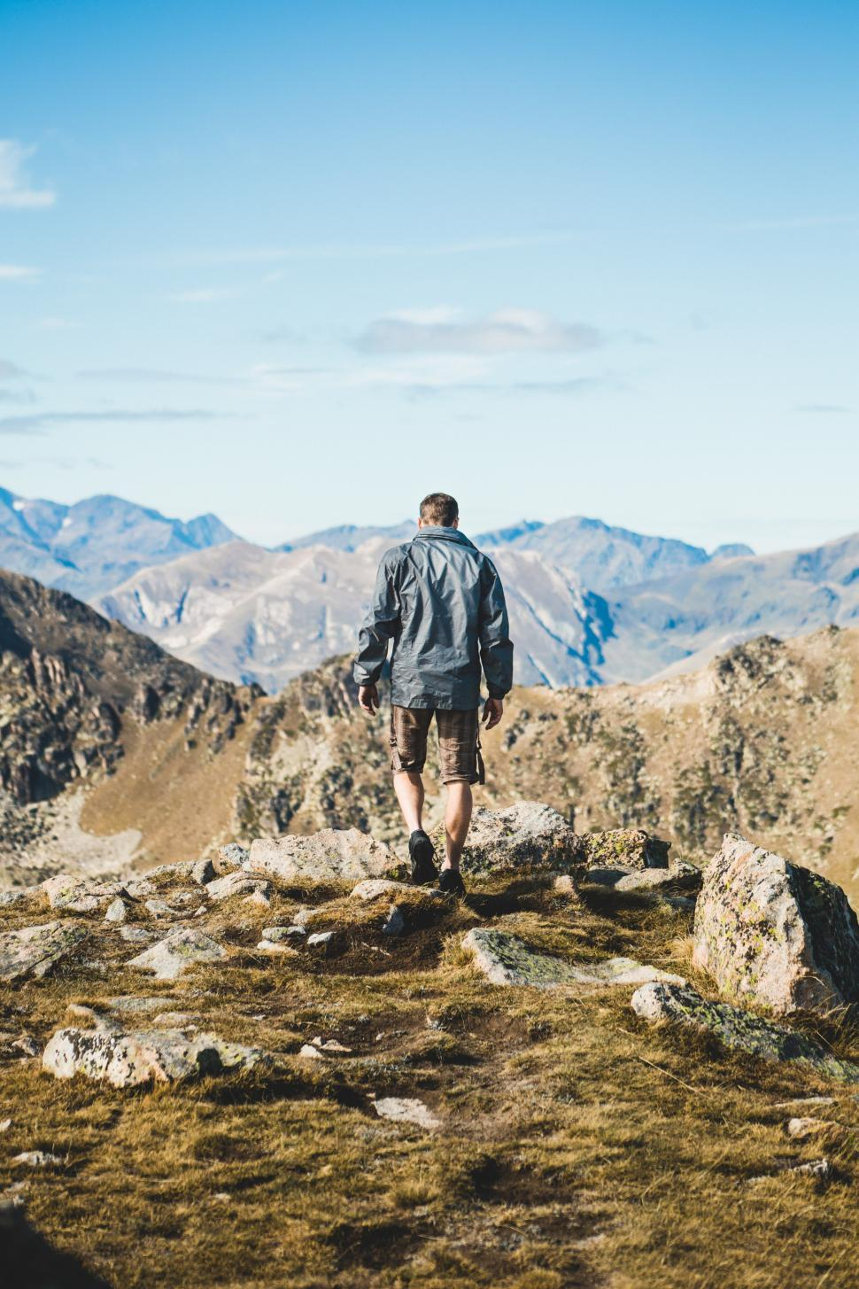 Download Free Stock HD Photo of A young caucasian hiker in the mountains Online