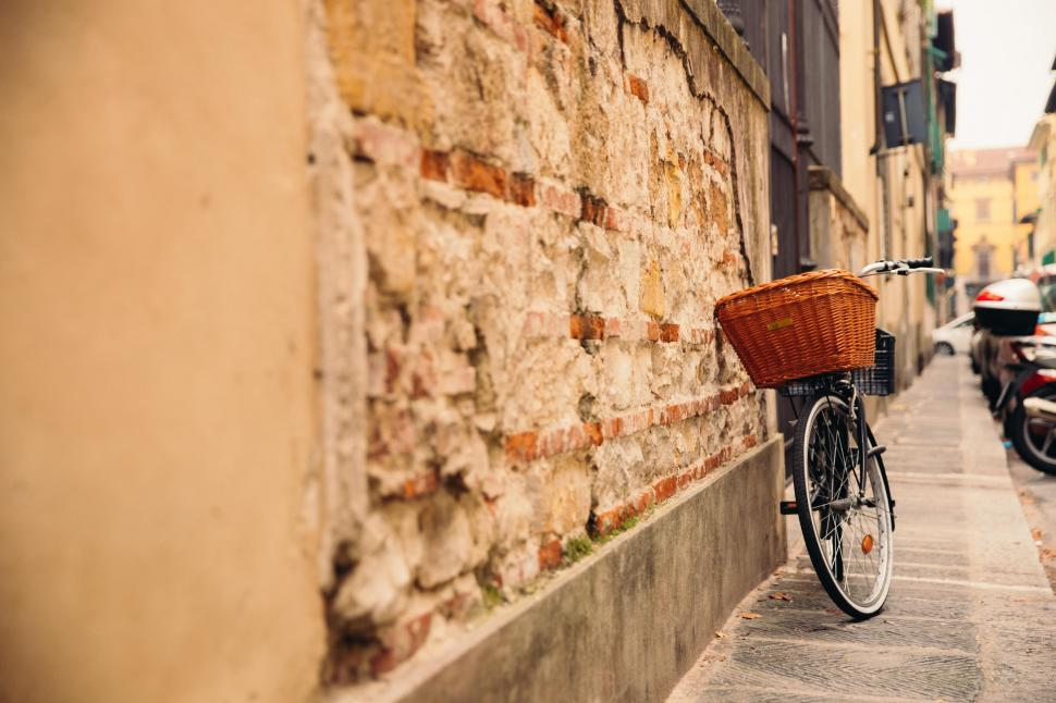 Download Free Stock HD Photo of A bicycle leaning on the wall Online