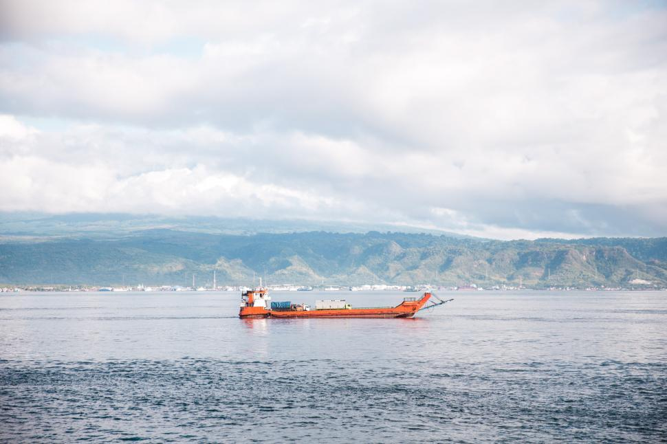 Download Free Stock HD Photo of Transport by barge on a body of water in Indonesia Online