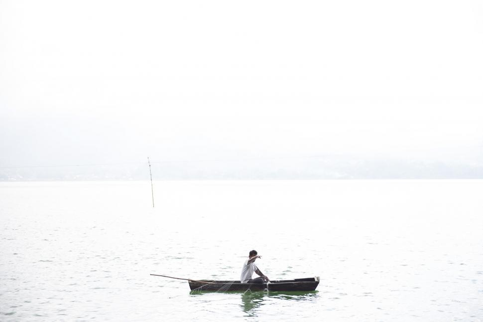 Download Free Stock HD Photo of A fisherman in a fishing boat Online