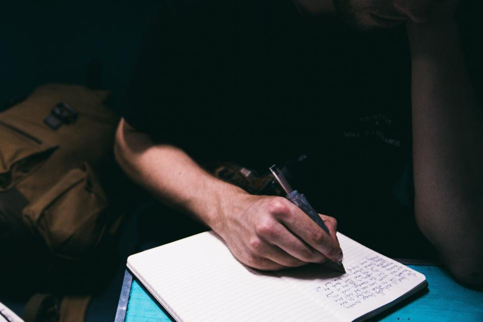 Download Free Stock HD Photo of A journalist writing on notepad Online