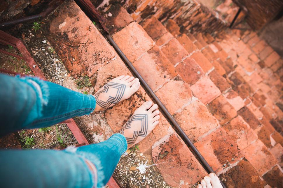 Download Free Stock HD Photo of Tattooed female feet on steep staircase Online