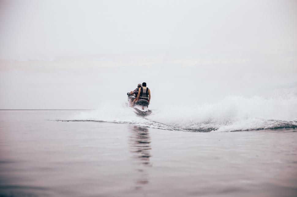 Download Free Stock HD Photo of Jet ski making waves on the beach Online
