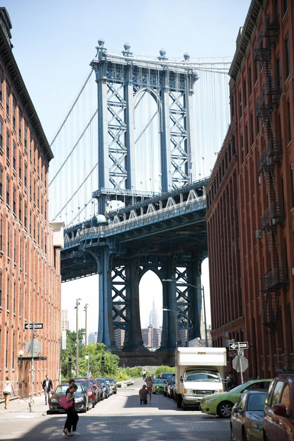 Download Free Stock HD Photo of A view of Manhattan Bridge from a busy neighbourhood Online