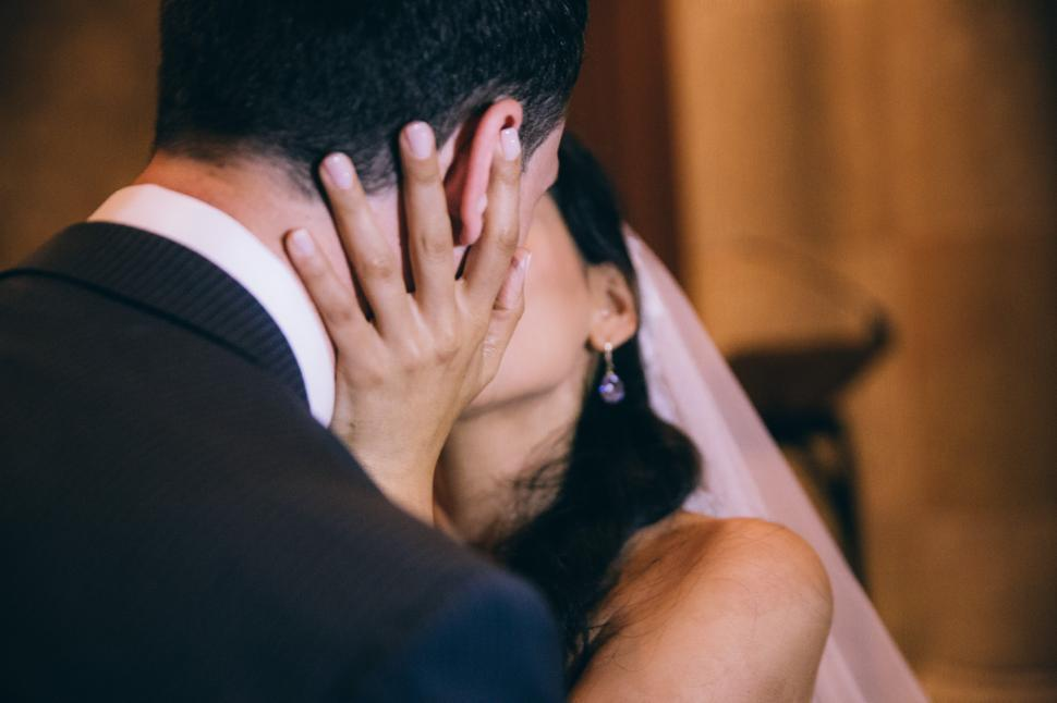 Download Free Stock HD Photo of Bride and groom kissing at wedding Online