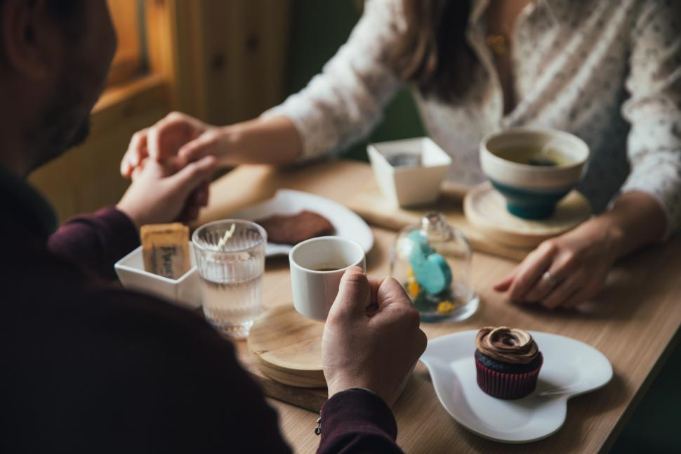 Download Free Stock HD Photo of A young couple on a coffee date Online