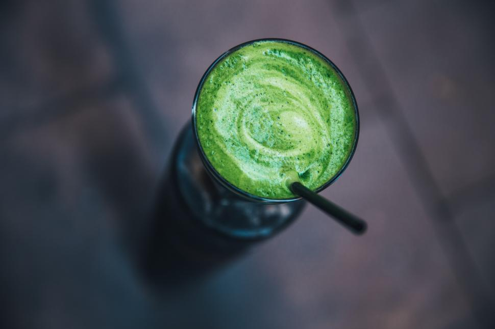 Download Free Stock HD Photo of Green smoothie served in a glass Online