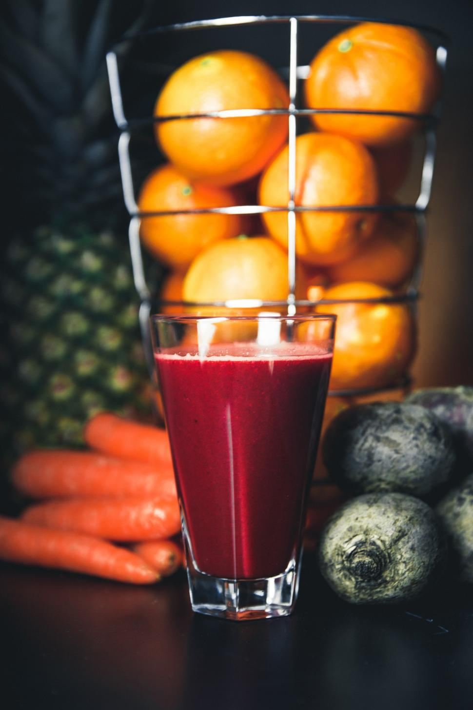 Download Free Stock HD Photo of Close-up of a glass of beetroot juice with other fruits Online