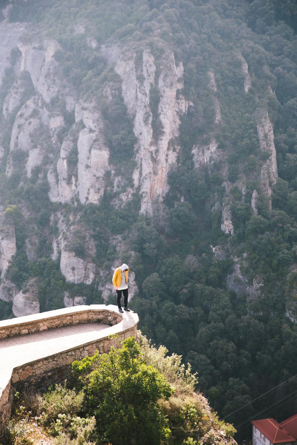 Download Free Stock HD Photo of A hiker standing on the edge of a viewing platform in Montserrat Online