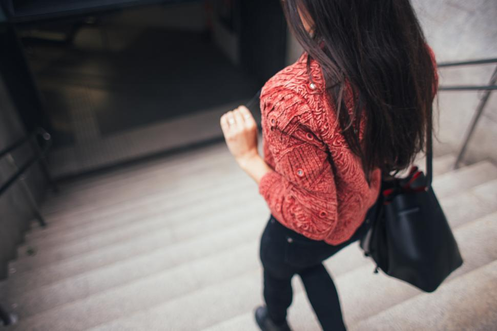 Download Free Stock HD Photo of A young brunette descending stairs Online