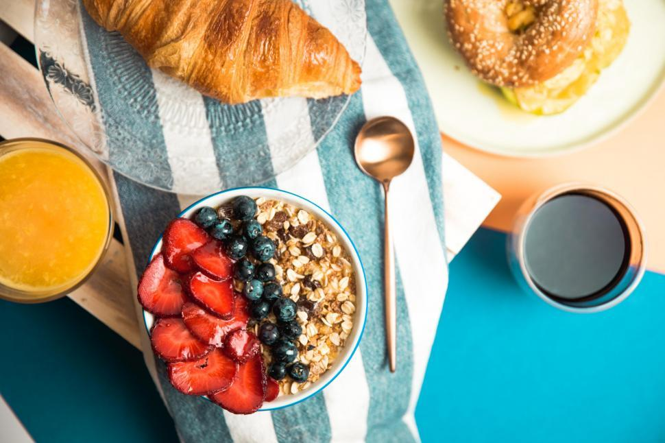 Download Free Stock HD Photo of Strawberries and granola on a breakfast table Online