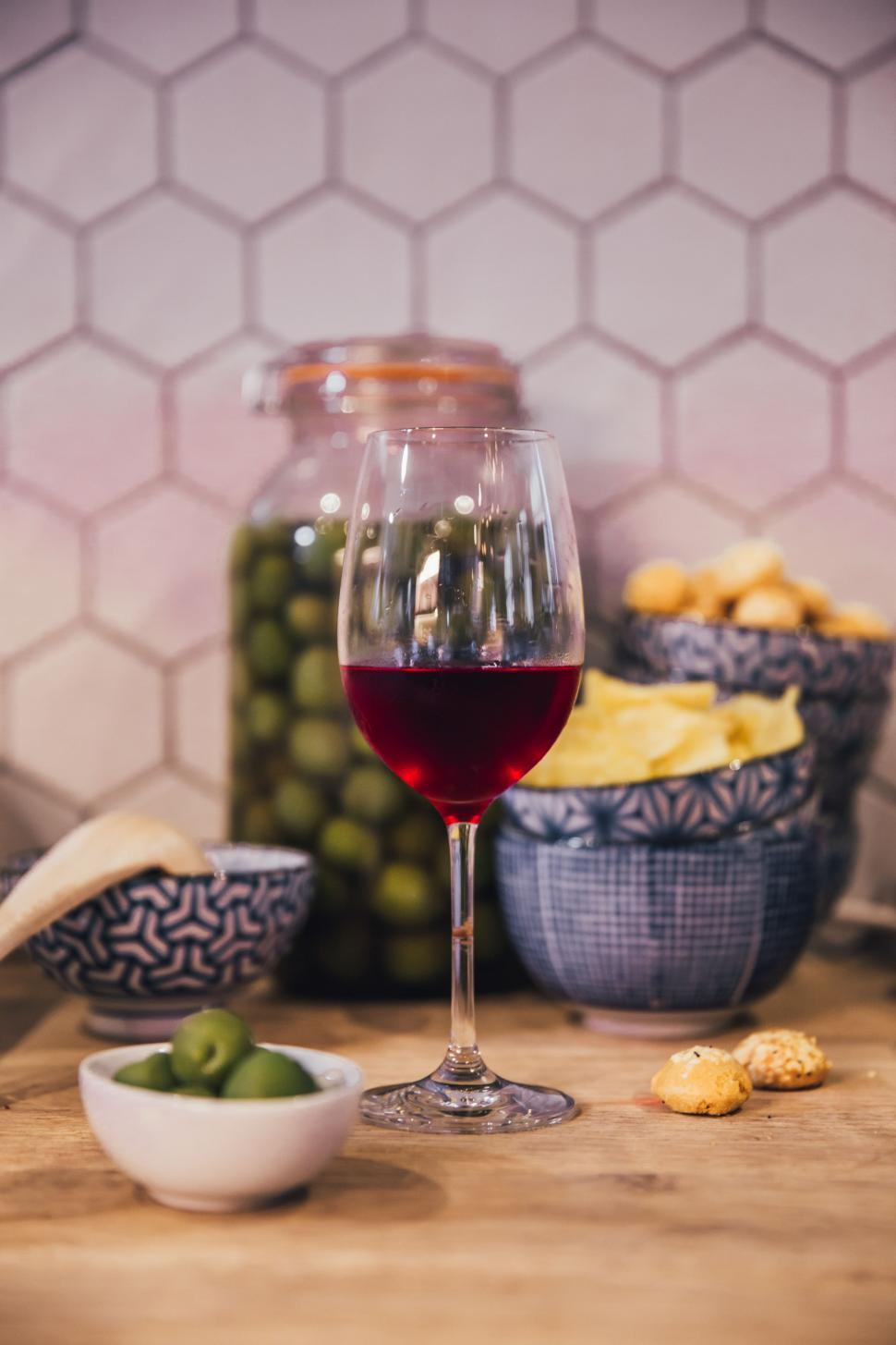Download Free Stock HD Photo of Red wine and olives in the kitchen Online