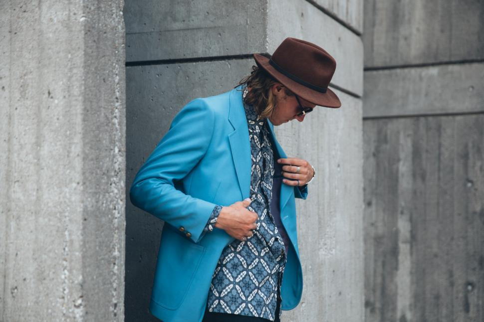 Download Free Stock HD Photo of A young caucasian man wearing turquoise blue jacket posing outdo Online