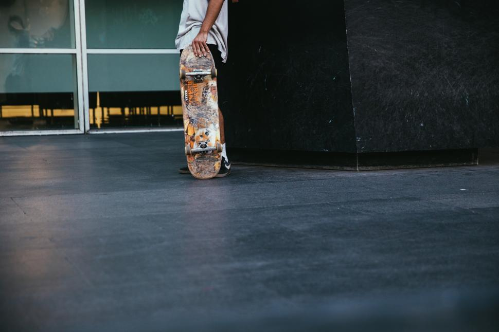 Download Free Stock HD Photo of A skateboarder holding skateboard in hand Online
