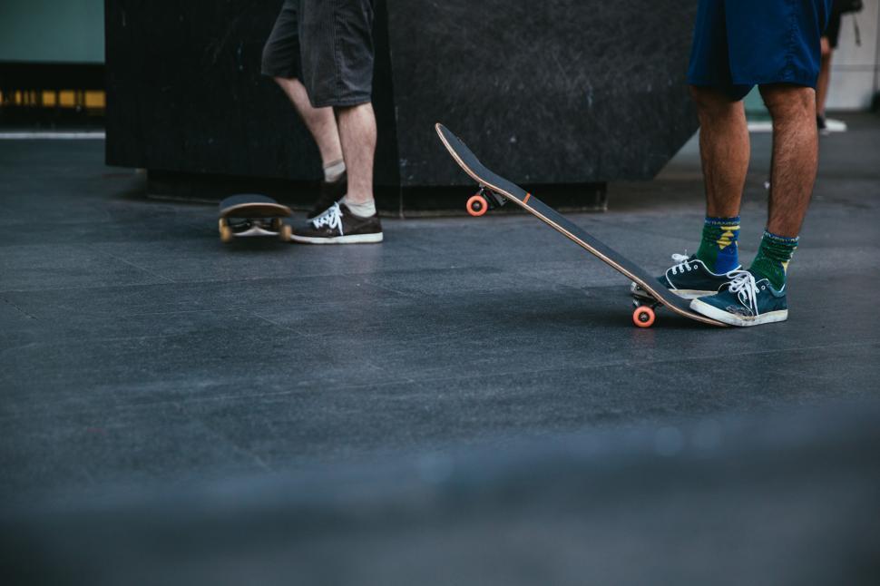Download Free Stock HD Photo of Skateboarders stepping on skateboard Online