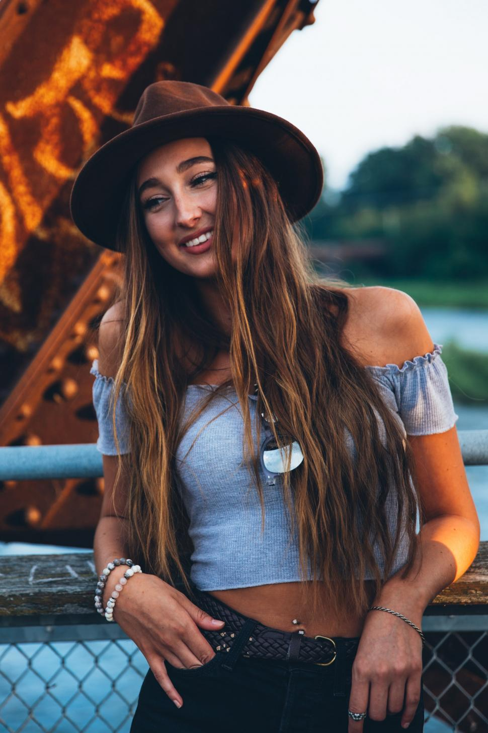 Download Free Stock HD Photo of A young caucasian woman smiling at sunset Online