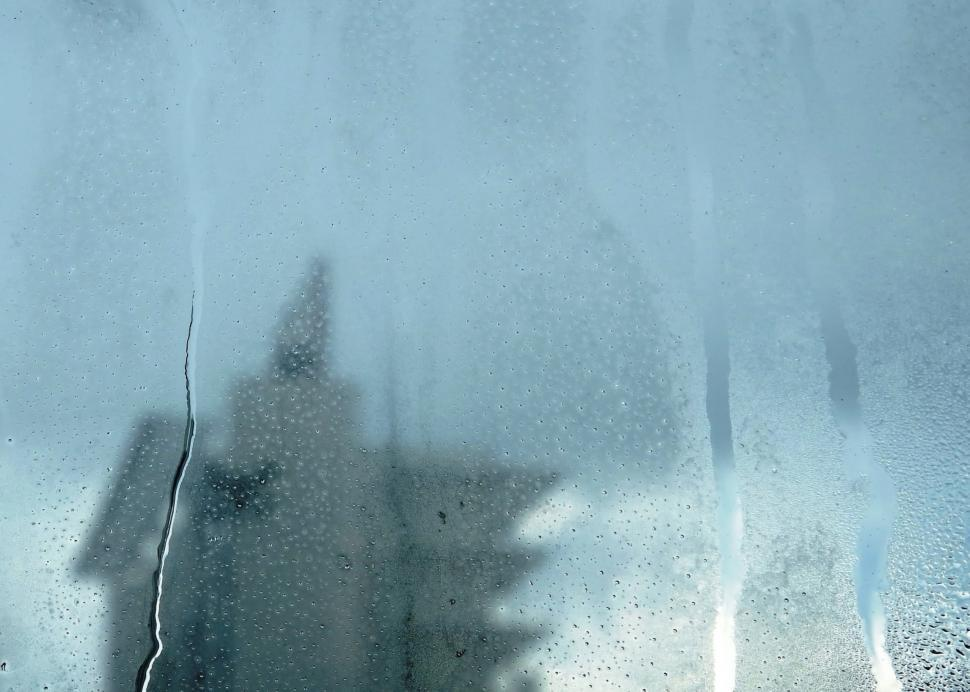 Download Free Stock HD Photo of Urban abstract background of a tower block seen through a misted window with raindrops  Online
