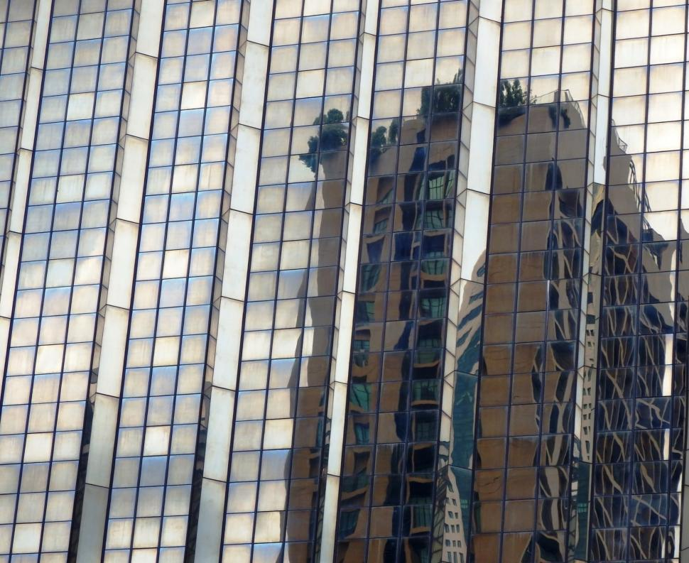 Download Free Stock HD Photo of Abstract high-rise building reflection in the glass facade of a modern skyscraper  Online