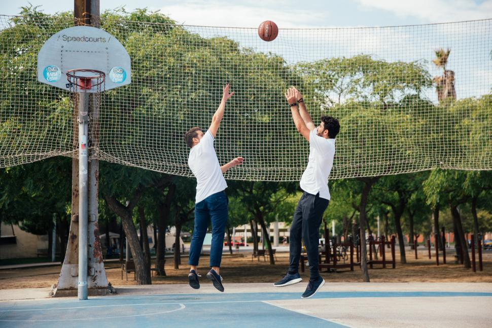 Download Free Stock HD Photo of Two young men playing basketball Online