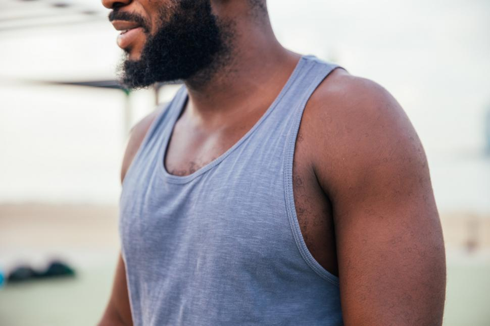 Download Free Stock HD Photo of A young African man in tanktop Online