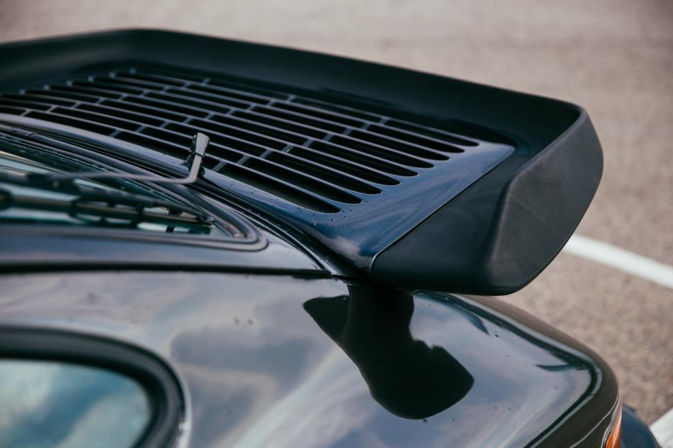 Download Free Stock HD Photo of Side view of a black sports car spoiler Online