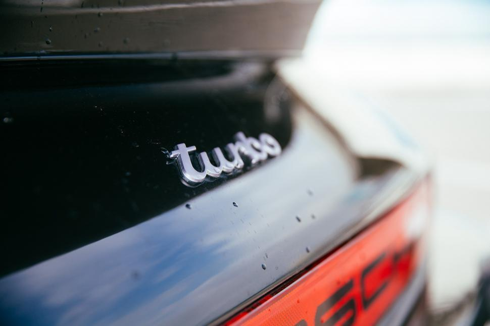 Download Free Stock HD Photo of Turbo detail on a black sports car Online