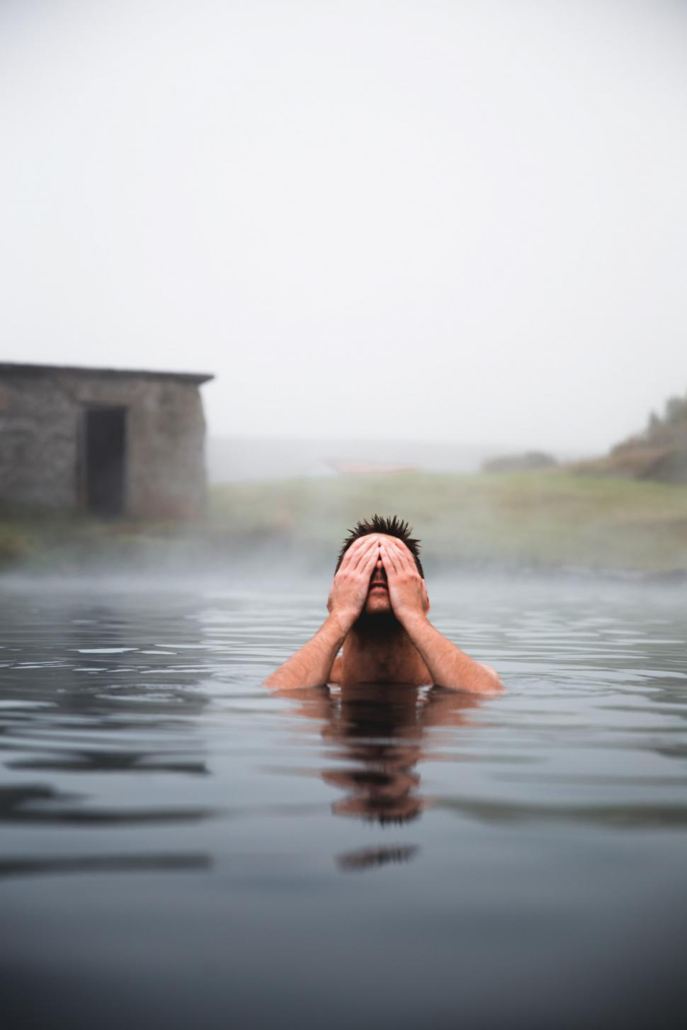 Download Free Stock HD Photo of A young caucasian man in a volcanic pool Online