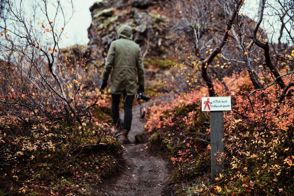 Download Free Stock HD Photo of A hiker in hooded jacket hiking through the bush Online