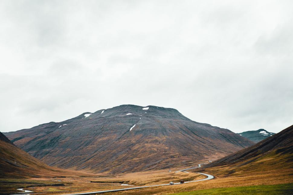Download Free Stock HD Photo of A winding road through volcanic hills Online