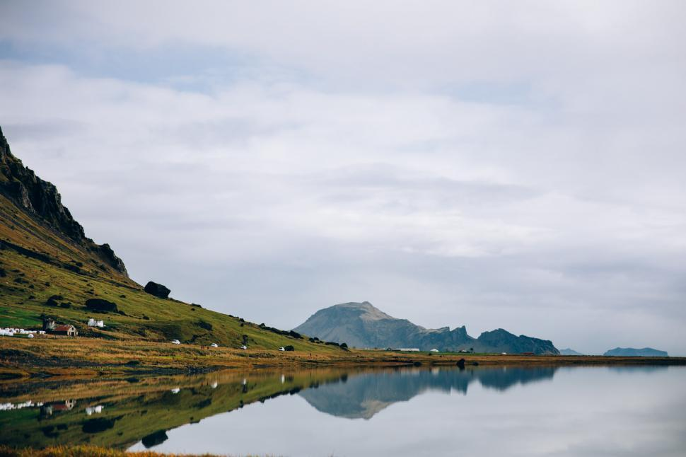 Download Free Stock HD Photo of Reflection of mountains in a glassy Iceland lake Online