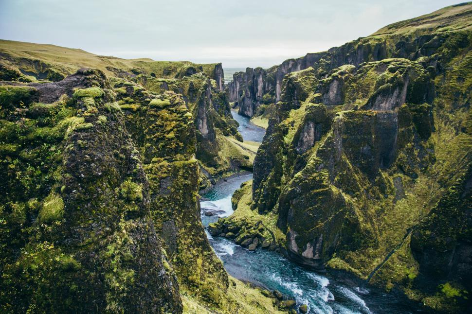 Download Free Stock HD Photo of Moss-grown mountain cliffs by glacial stream Online